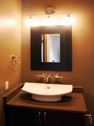 Track Lighting Bathroom Vanity by Track Lighting Attached On Black Wooden Bathroom Vanity Behind