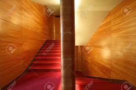 modern stairway wood wall and velvet carpet stock photo