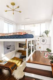 chic modern bedroom with loft bed also moroccan bedding and gold