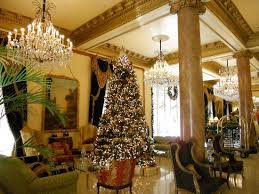 one of the two christmas trees in the lobby picture of le
