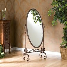 decorating jewelry cheval mirror with wooden floor and curtains