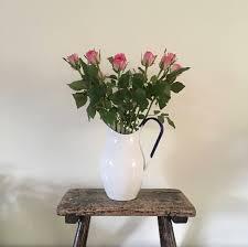 vintage style enamel pitcher jug flower vase white with a blue