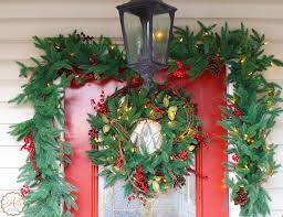 beautiful lighted garland and front door wreath an alli event