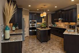 model kitchens dark cabinets and light tile finish give this
