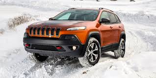 2016 jeep cherokee sport red off road in the snow with jeep