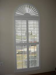 Plantation Home Interiors Decorating Chic White Sunburst Shutters With Arc On Cream Wall