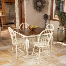 white dining table set for four lounge to lawn