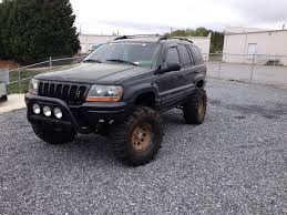 jeep station wagon lifted huge mudders on lifted jeep grand cherokee wj jeep grand