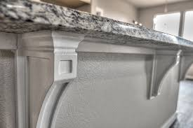 arched ashen white slab granite kitchen island with cool coribles
