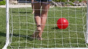 Kids Playing Backyard Football Child Playing Football On A Green Lawn Little Barefoot