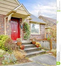 beautiful brick house with red entrance door royalty free stock