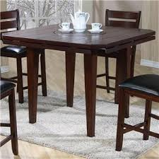 dining table with rotating primo international 4540 drop leaf gathering height table with