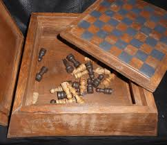 very unusual large carved wooden pawn housing a chess set and