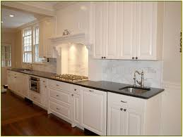 Stone Backsplashes For Kitchens by Granite Countertop Mission Style Cabinet Doors Stone Backsplash