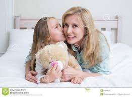 girls kissing in bed cute kissing her smiling mother stock image image 51084633
