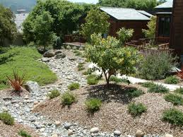 berms and dry creekbed designed by ann breemer designs