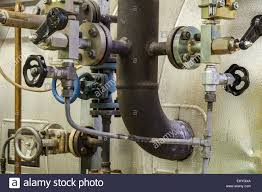 Faucet Pipes Pipes And Faucet Valves Of Heating System In A Boiler Room Stock
