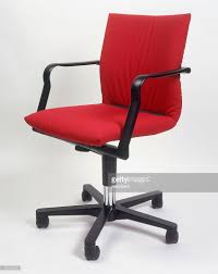 red office chair with black plastic arm rests stock photo getty