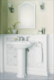 bathroom pedestal sink vanity with graff faucets and towel bar