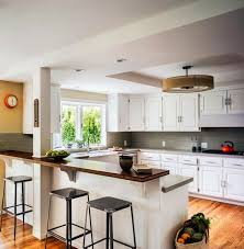 peninsula kitchen designs with integrated high seating areas and