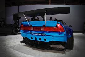 mazda rx7 rocket bunny kit sema 2014 nitto tire unveils autofashion u0027s rocket bunny nsx revved