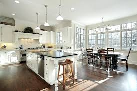 open kitchen with island open kitchen island exle of a transitional u shaped kitchen