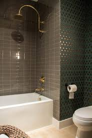 neutral ceramic shower tiles provide a striking welcome contrast