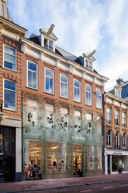 Doctors In Amsterdam I Amsterdam Mvrdv Replaces Traditional Facade With Glass Bricks That Are