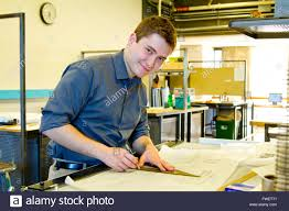 an architect studies in his college work building while drawing