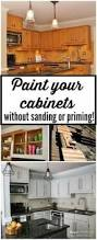 How To Paint Your Kitchen Cabinets by Painting Laminated Cabinets How To Repair And Paint Them