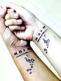 matching music themed best friends wrist tattoos wrist tattoos