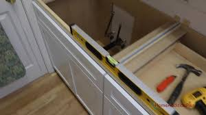 how to install base cabinets in laundry room how to install lower cabinets in a laundry room