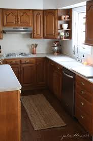 how to lighten dark cabinets without painting a simple kitchen makeover without paint
