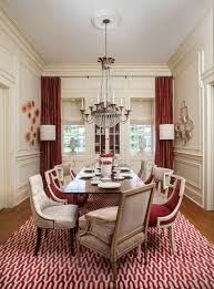 elegant dining room with red curtains and hanging crystal