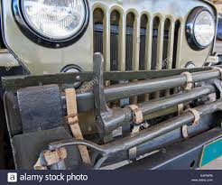 front of an old army jeep vehicle with grille and tools stock