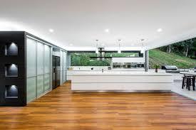 modern gas kitchen with fish tank and open plan pillars interior