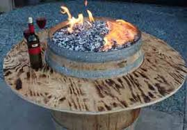 Wine Barrel Fire Pit Table by 19 Creative Uses For Old Wine Barrels Outdoors
