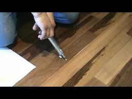 How To Install Hardwood Floors On Concrete Without Glue - how to repair a popping floor glue down or floating part 1 youtube