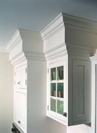 how to add crown molding to kitchen cabinets hide kitchen soffit with molding and crown molding kitchen
