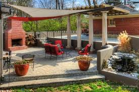 paver patio with fire pit fountain pergola and custom fabric