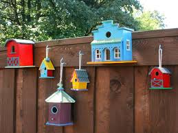 Backyard Fencing Ideas by Exterior Beauty Colorful Decorative Birdhouses On Brown Wooden