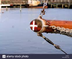 denmark the danish flag painted on the end of the pole stock photo
