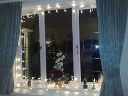 strings of lights and white orchids