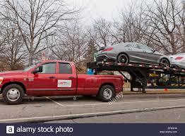 Dodge Ram Pickup Truck - dodge ram pickup truck mounted with car trailer usa stock photo