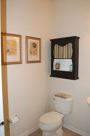bathroom cabinets space over the toilet should always small