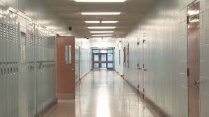 hallway slow zoom down a long empty high hallway lockers lining