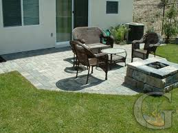 outstanding concrete patio designs with fire pit including home