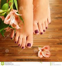 female feet at spa salon on pedicure procedure royalty free stock