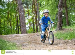 raincoat for bike riders happy funny little kid boy in colorful raincoat riding his first
