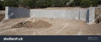 backyard concrete wall foundation walk out basement stock photo